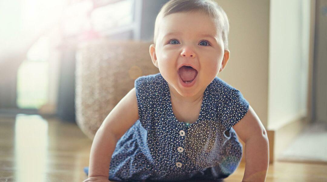 Happy baby girl crawling