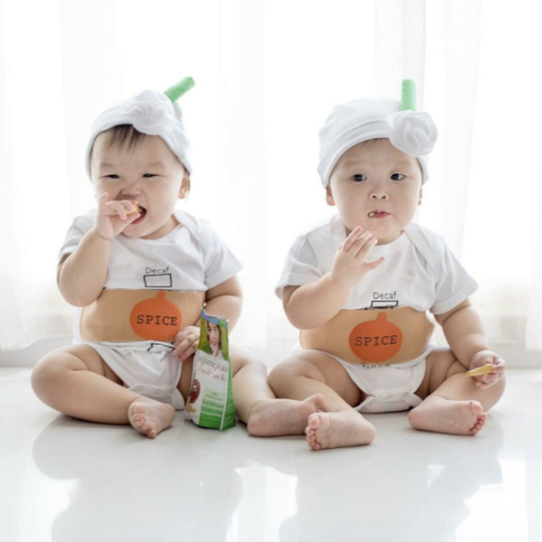 twin baby girls dressed up as pumpkin spice lattes