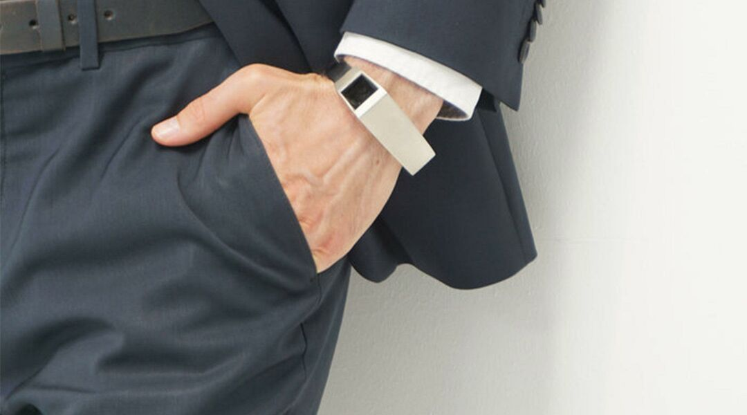Man in suit wearing Fibo smart watch