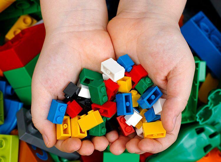 Child holding legos