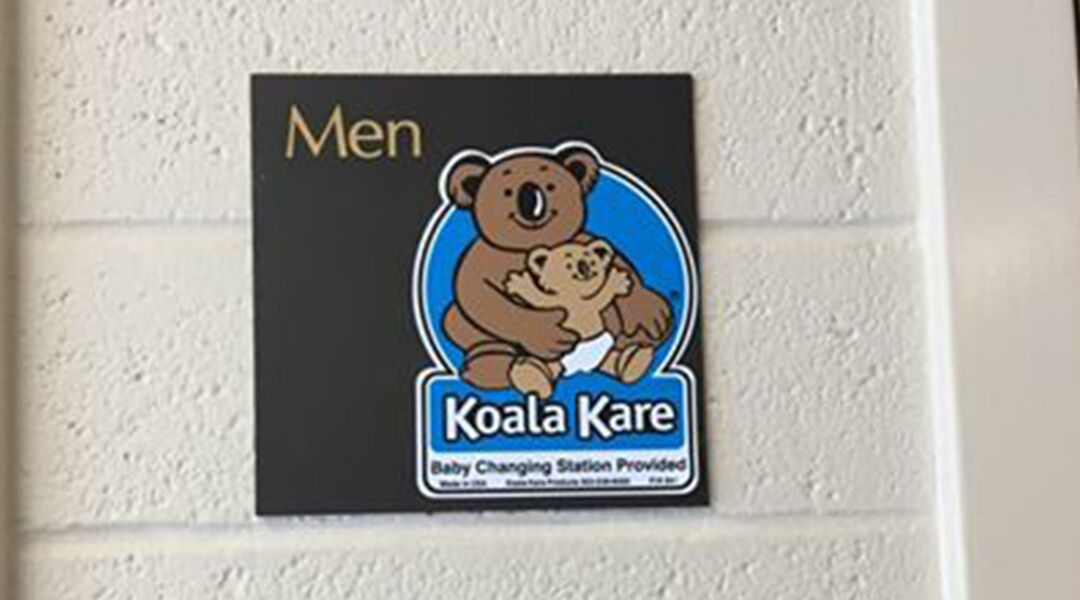 changing table sign in men's restroom