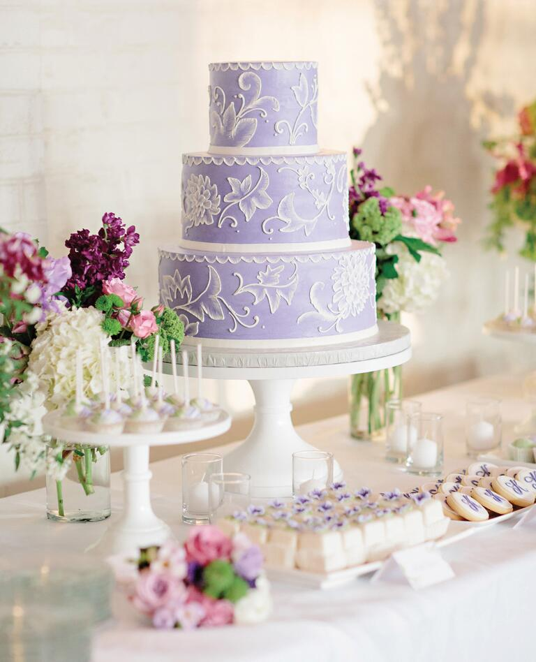 Lavender wedding cake on a dessert table