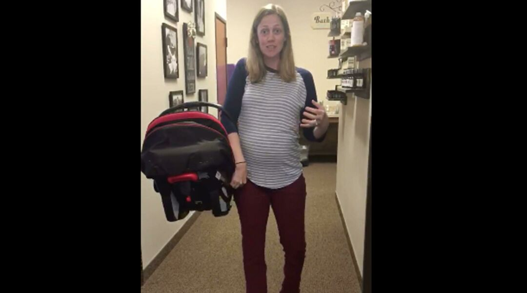 dd5d8165e88 Chiropractor Shows Correct Way To Hold A Car Seat