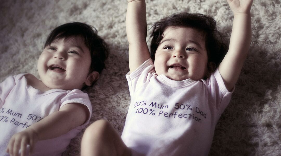 happy excited baby twins